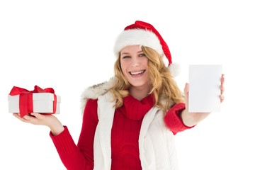 Festive blonde holding gift on right hand