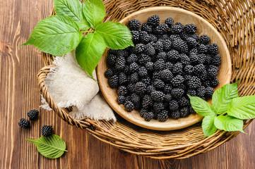 Blackberry in wooden bowl in basket