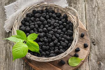 Blackberry in big basket on wooden table