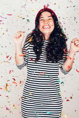 Happy party girl with confetti