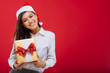 Attractive girl with Christmas present