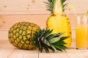 Sliced and whole pineapple
