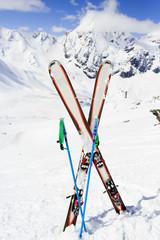 Ski, mountains and ski equipments on ski run