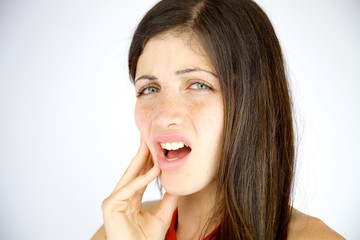 Young woman feeling strong teeth pain