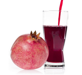 pomegranate and a glass of juice