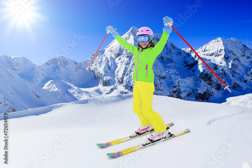 Skiing, winter sport - skier on mountainside - 72654459