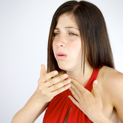 Sick woman coughing isolated