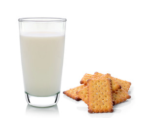 Glass of milk and cracker isolated on white