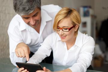 Businesswoman and businessman analyzing sales