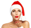 Beauty Fashion Girl with Santa Hat Sending a Kiss