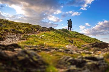 Male hiker standing in high peak