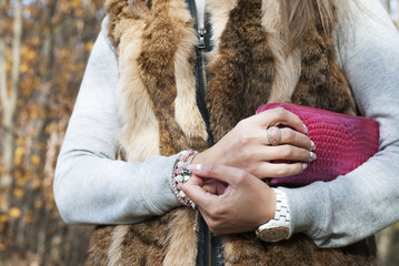 Women's hands holding the purse