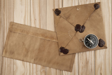 old letters and compass