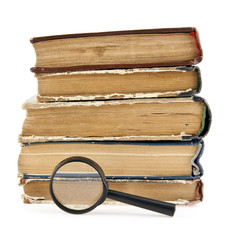 magnifier and old books