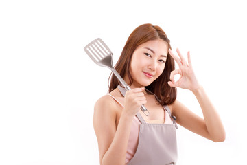 cooking woman giving ok hand sign to you, white isolated