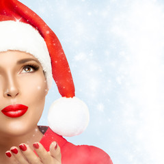 Christmas Woman in Santa Hat Looking Stardust Falling
