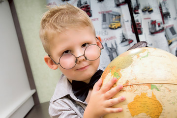 Cute boy and globe