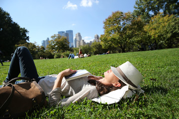 Profile view of woman relaxing in Central Park, NYC