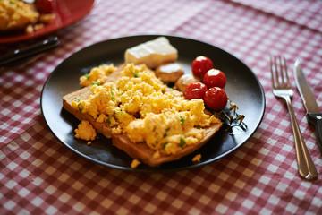 Scrambled eggs on toasted wholegrain bread