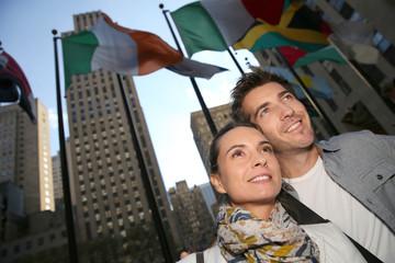 Couple standing by the Rockfeller center in New York City