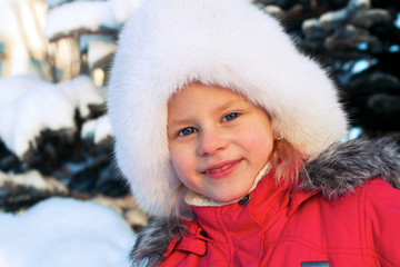 little girl in a white fluffy hat