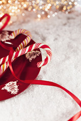 Candy Canes On Red Plate With Christmas Decoration Around
