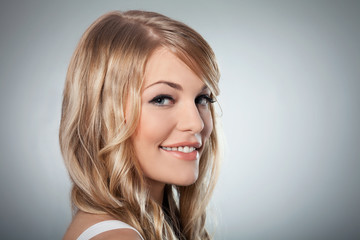 Portrait of a beautiful blond woman smiling