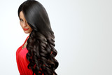 Hair. Portrait of Beautiful Woman with Black Wavy Hair. High qua