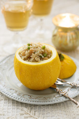 Yellow zucchini, stuffed with quinoa, chickpeas and herbs