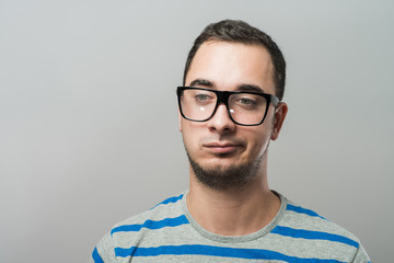 Resentful young man in glasses