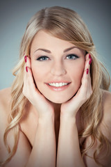 Portrait of a beautiful blond woman with a perfect smile.