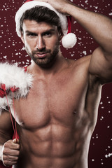 Manly and muscular santa claus with christmas presents