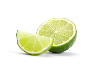 Limes with slices isolated on white background © ZaZa studio