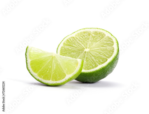 Limes with slices isolated on white background - 72665224