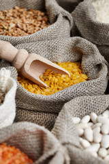 Corn kernel seed meal and grains in bags isolated on a wood tabl