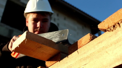 Builder with handsaw