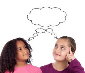 Two beautiful little girl thinking