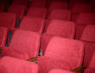 Empty red seats for cinema theater conference or concert
