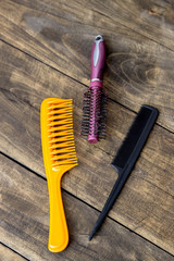 hair brushes on wooden table