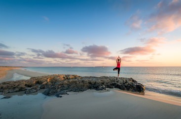Island beach sunrise and yoga practice