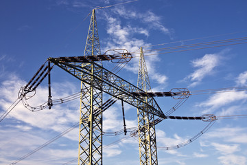 electric pylons with a blue sky