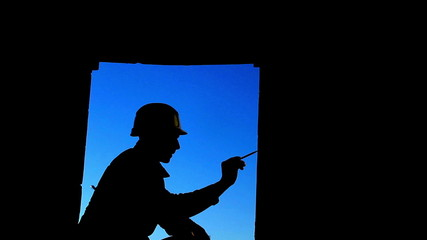 silhouette adult builder with hammer and pencil