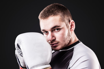 Young boxer on black