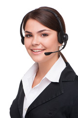 Smiling young business woman with headphones