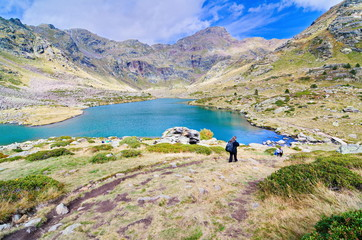 People hiking to Estany Primer in Tristaina, Andorra