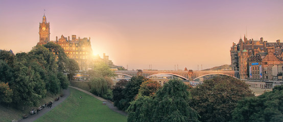 Panoramic view of Edinburgh, Scotland, UK with the setting sun