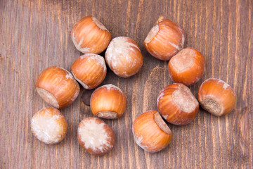 Hazelnuts on wooden table seen from above