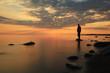 Leinwandbild Motiv man meditates on the lake