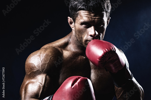 Deurstickers Vechtsport Young man looking aggressive with boxing gloves. Caucasian male