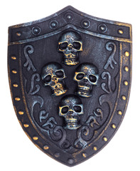 Middle age metallic shield with skulls